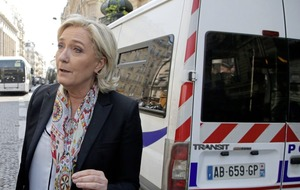 Workers boo Marine Le Pen as she visits Paris food market