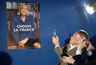 Marine Le Pen upstages presidential rival with surprise stop at factory
