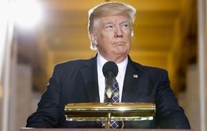 Donald Trump has a button in his desk that brings him a Coke