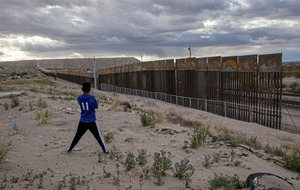 Trump backs down on border wall-funding demand to secure spending bill