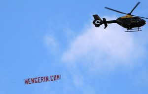 A 'Wenger In' banner flying over the Etihad stole the show at the Manchester derby