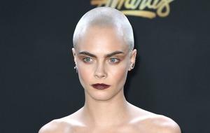 Cara Delevingne shows off shaved head at MTV Awards