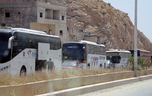 Hundreds of Syrian rebels and their families evacuated from Damascus