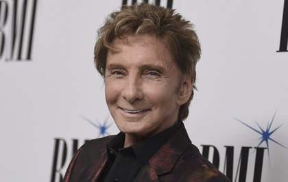 He writes the songs - and now Barry Manilow has an award to prove it ...