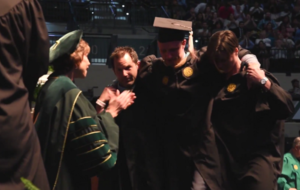 This wheelchair-bound student walking to collect his Masters degrees is the most inspiring thing you'll see all day