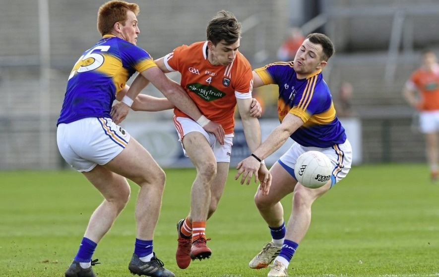 Armagh defender Paul Hughes takes the road less travelled