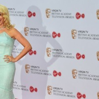 Heavens rain on Bafta parade after stars opt for spring-themed outfits