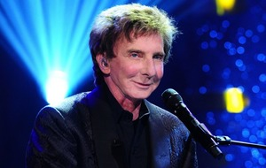 Barry Manilow postpones two shows to rest vocal cords