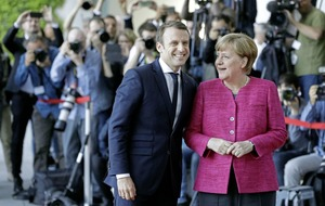 Macron and Merkel promise 'roadmap' of EU reforms in new French president's first full day in office