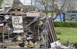 Picket fence at bonfire site to keep fly-tippers out