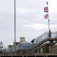 Police will not remove flags at train station near Belfast City Airport