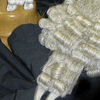 Two barristers clear first stage of legal battle to prevent being named among Northern Ireland's top 100 legal aid earners