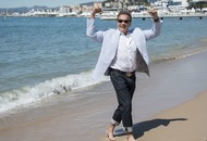 Arnold Schwarzenegger dips his toes in the Cannes waters