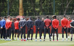 Manchester United players held a minute's silence in training in memory of the terror attack victims