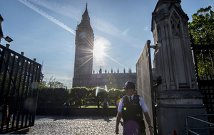 Armed police hold man at gunpoint near Houses of Parliament in Westminster