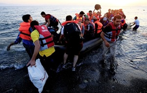 20 migrants drown when boat capsizes off Libya