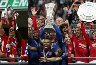 Manchester United fans are calling it the 'wooden treble' and we absolutely love it