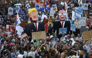 People have taken to the streets in Brussels to protest against Donald Trump's visit