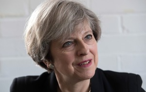 Theresa May calls for more action by tech giants over online extremism