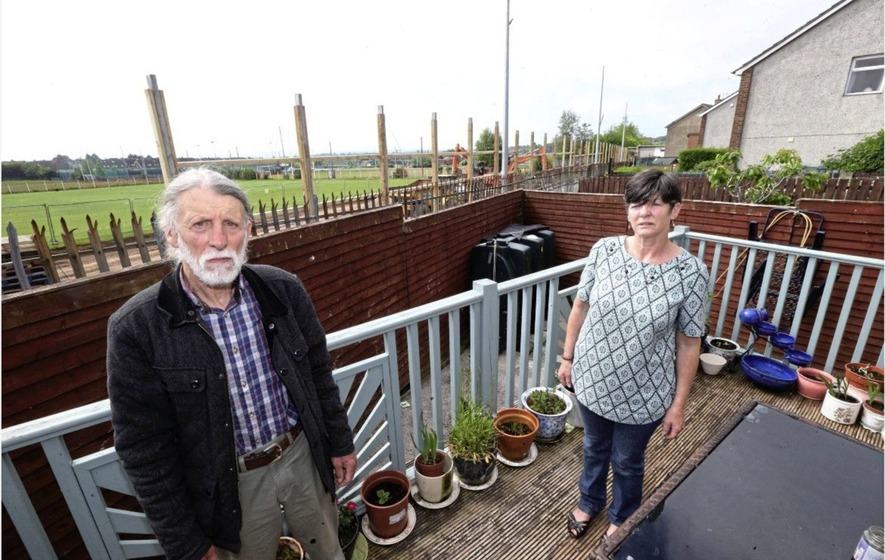 Residents call on west Belfast GAA club to reconsider fencing plans which will ruin view from their homes