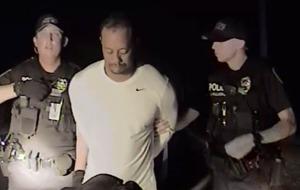 Video: Dazed golf great Tiger Woods struggles to walk in police arrest