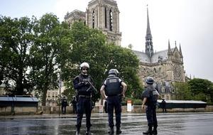 Hundreds of tourists held inside Notre Dame after Paris police shoot hammer-wielding assailant