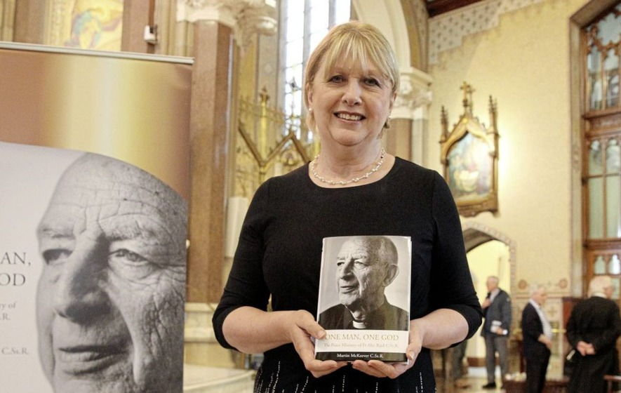 Former president Mary McAleese helps launch Fr Alec Reid book
