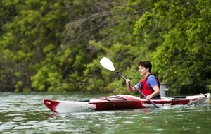 Justin Trudeau paddled across a river in a kayak to talk to families about climate change