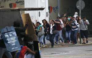 Teenage protester and guardsmen killed as Venezuela unrest continues