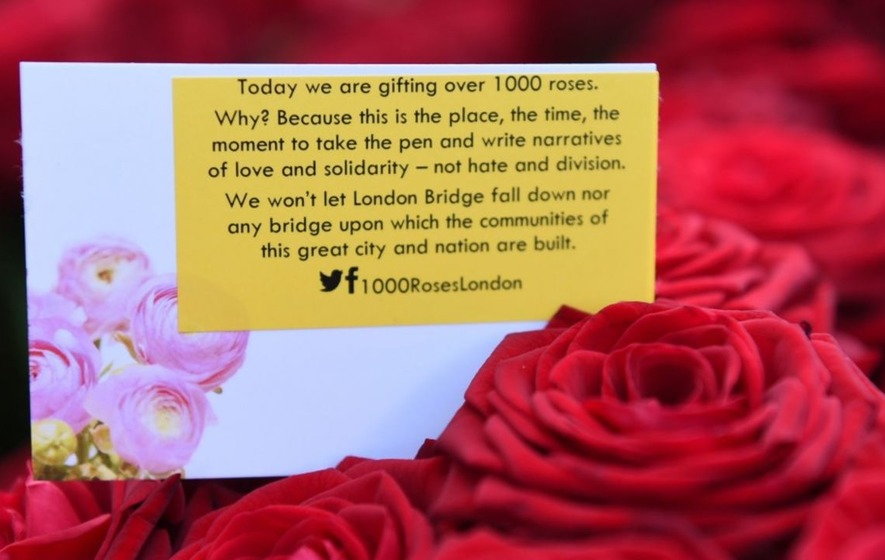 Muslims have been handing out thousands of roses to passers-by on London Bridge