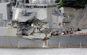 Bodies found during rescue mission to find seven US sailors missing after their destroyer hit merchant ship
