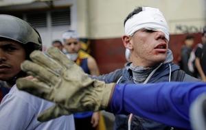 Venezuela's foreign minister walks out of diplomats meeting discussing political crisis,