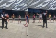 This policeman laying down some moves with a dance troupe is the video we all need right now