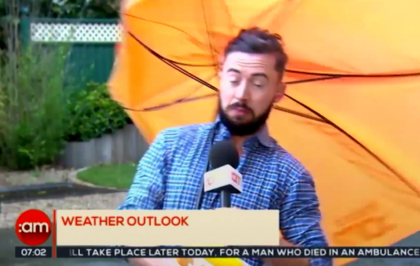 Video:   TV3 weatherman learns the hard way not to use a huge umbrella in strong winds