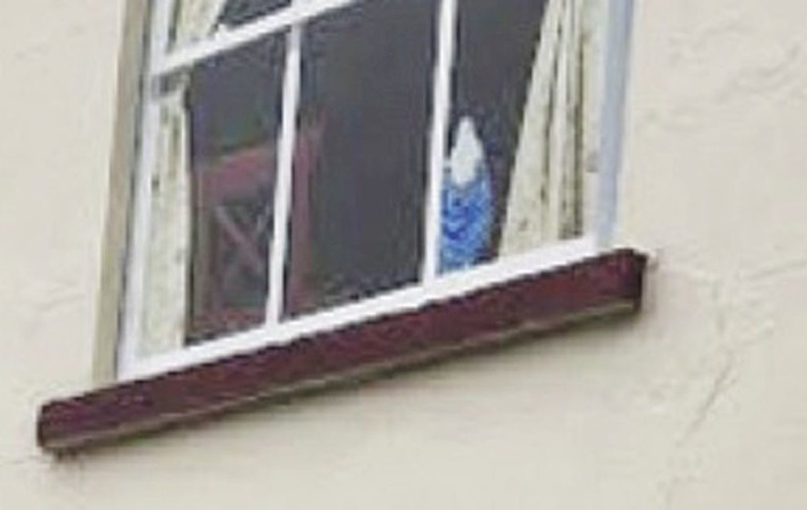 Complaint lodged over painting of Virgin Mary statue in fake shop front in Dungiven