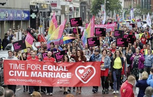 Thousands march on Belfast City Hall for same-sex marriage rights