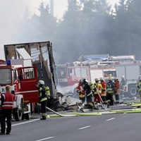German police say 18 people dead after bus crashes and bursts into flames