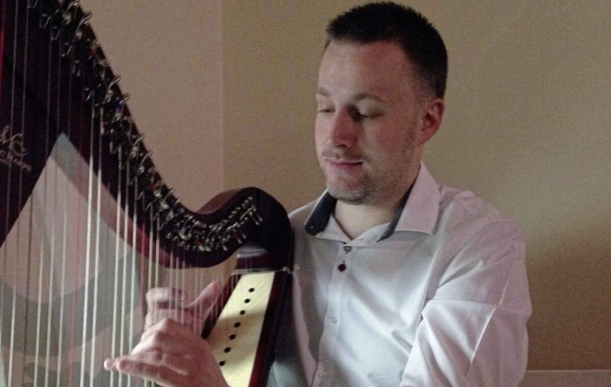 Mark Mooney `blessed many' with his music, mourners told