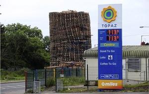 Towering loyalist bonfire built near petrol station