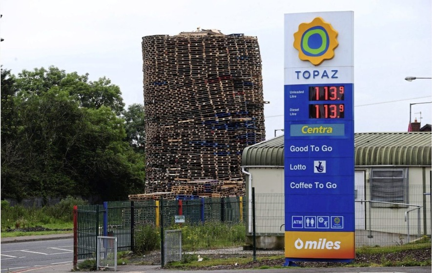 Towering loyalist bonfire built near petrol station
