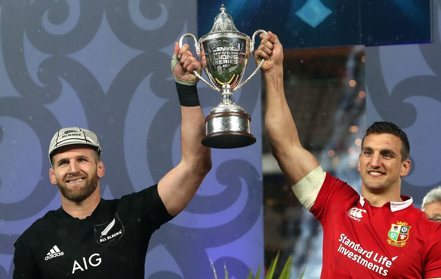 Sam Warburton and Kieran Read collecting the Lions series trophy jointly made for some pretty awkward photos