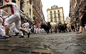 Two injured at fourth running of the bulls in Pamplona