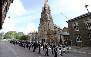 Video: Orange march passes St Patrick's Church Belfast to just a single drum beat