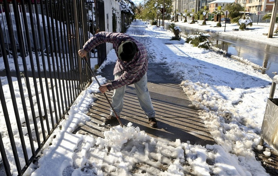 Chile turns chilly as Santiago hit by rare snowfall