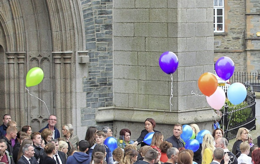 Classmates of Donnacadh Maguire release balloons at funeral of six-year-old in Derry