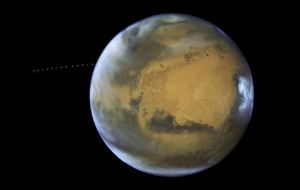 This is the moment Mars was inadvertently photobombed by a tiny moon named Phobos