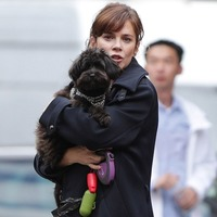 Anna Friel cuddles dog Maggie May on Marcella set