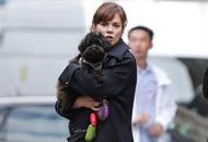 Anna Friel cuddles dog Maggie May on Marcella set