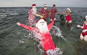 It may be the middle of summer but Santas are flocking to the World Santa Congress