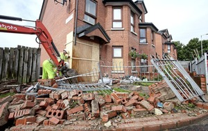 Family relieved to still be alive after car crashes into house in west Belfast